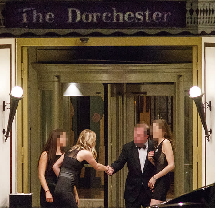 Guests outside The Dorchester Ballroom entrance during the annual Presidents Club Charity Dinner in London on January 18, 2018.