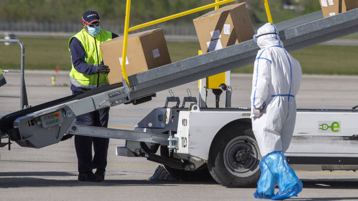 Medical supplies from China are unloaded in Geneva. The country has been criticised for exporting defective testing kits and medical masks