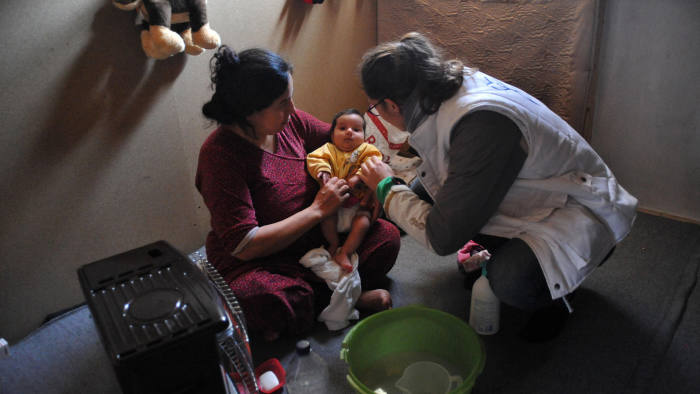 J39F0C Reportage on volunteers with the french charity, gynecologists without borders who work in refugee camps near calais in the north of france. midwife.