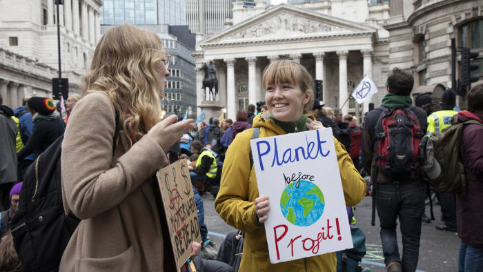 Climate change activists from Extinction Rebellion block the streets at Bank in the heart of the City of London financial district on 14th October 2019 in London, England, United Kingdom. Extinction Rebellion is a climate change group started in 2018 and has gained a huge following of people committed to peaceful protests. These protests are highlighting that the government is not doing enough to avoid catastrophic climate change and to demand the government take radical action to save the planet. (photo by Mike Kemp/In Pictures via Getty Images)