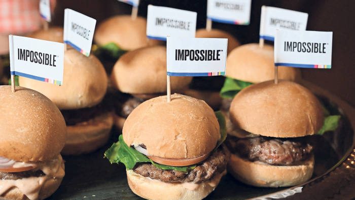 """The Impossible Burger 2.0, the new and improved version of the company's plant-based vegan burger that tastes like real beef is introduced at a press event during CES 2019 in Las Vegas, Nevada on January 7, 2019. - The updated version can be cooked on a grill and has a better flavor and lowered cholesterol, fat and calories than the original. """"Unlike the cow, we get better at making meat every single day,"""" CEO of Impossible Foods CEO Pat Brown. (Photo by Robyn Beck / AFP) (Photo credit should read ROBYN BECK/AFP/Getty Images)"""