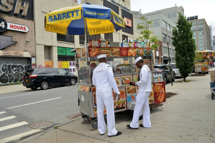 US Navy service members order food at a street vendor