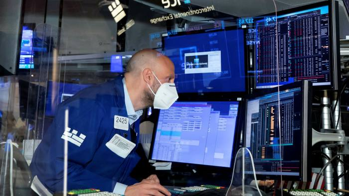 Trading specialist Meric Greenbaum works at his post on the trading floor of the New York Stock Exchange