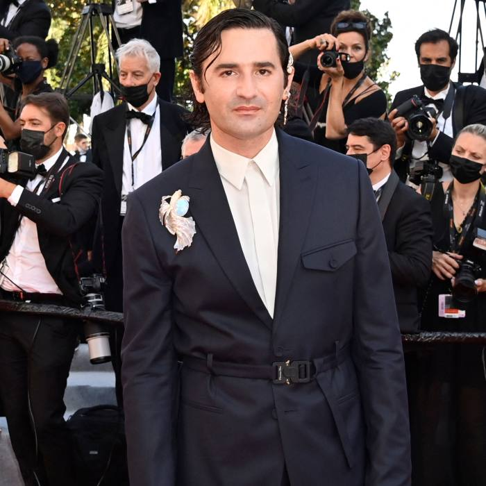 Nicolas Maury wears a Boucheron brooch at Cannes this year