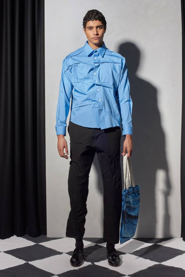 Blue Misfit shirt, £420, and black Misfit trousers, £410