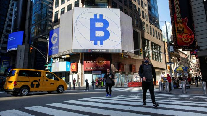 Crypto ETF assets treble as investors take risks Signage of the times: street advertising for bitcoin and Coinbase, the US cryptocurrency exchange that floated in April