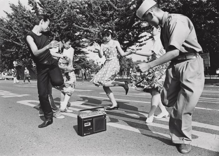 Teenagers dancing the Twist in a Tokyostreet, 1978