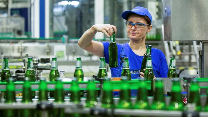 From barley to bar: Carlsberg calculates what it calls its 'beer-in-hand' emissions