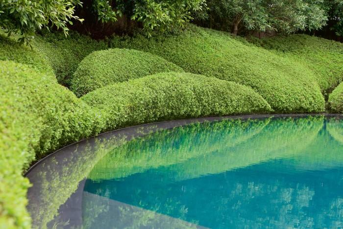 The crescent-shaped basalt pool in a garden in Kohimarama Beach, New Zealand