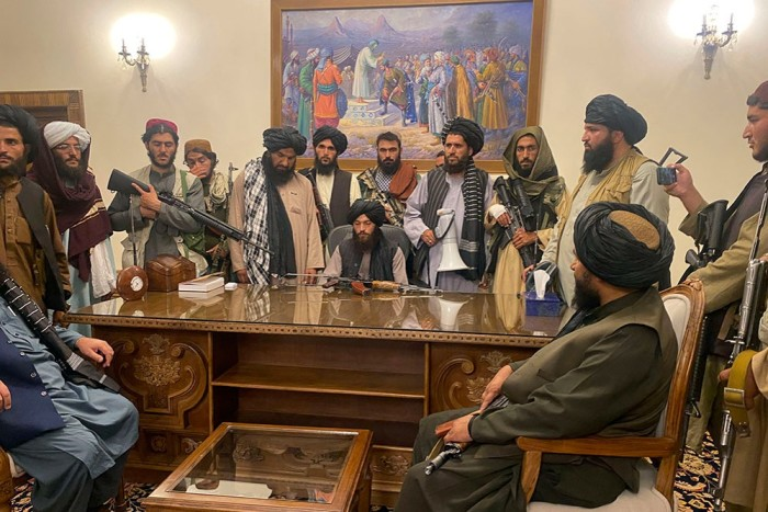 Taliban fighters installing themselves in the presidential palace in Kabul on August 15, after taking control of the city. President Ashraf Ghani fled later that evening