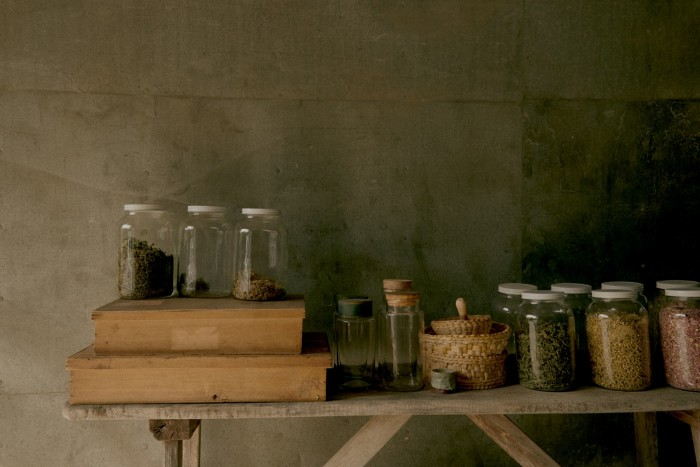 """Herbs stored in jars in the author's drying room (""""aka my garage!"""")"""