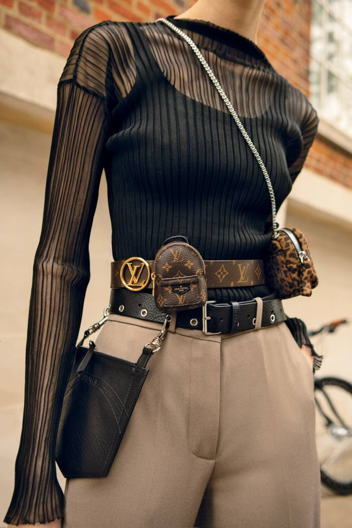 Drome sheer top, £480. Joseph wool Morissey trousers, £395. Top (seen underneath), model's own. Accessories, from bottom: D'Heygere leather and metal pocket belt, €280. Louis Vuitton monogram canvas leather LV Palm Springs belt, £825. Pierre Hardy suede leather Alpha Pad Nano bag, €395