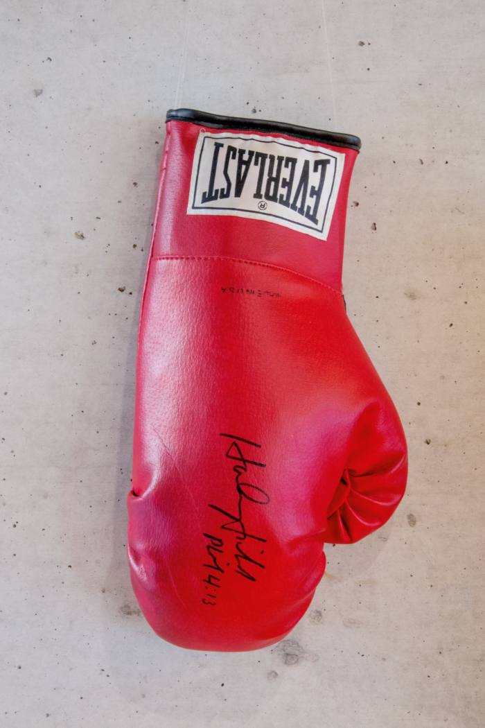 A boxing glove signed by heavyweight champion Evander Holyfield and gifted to Ando