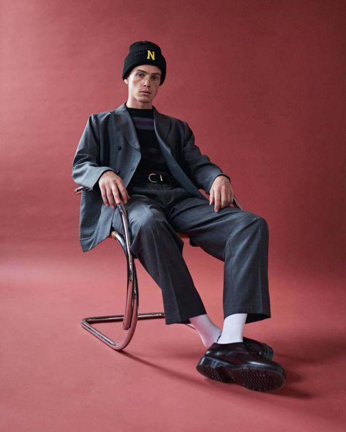 Noah jacket, $1,198, trousers, $578, sweater, $148, belt, $148, beanie, $32, and shoes, $200