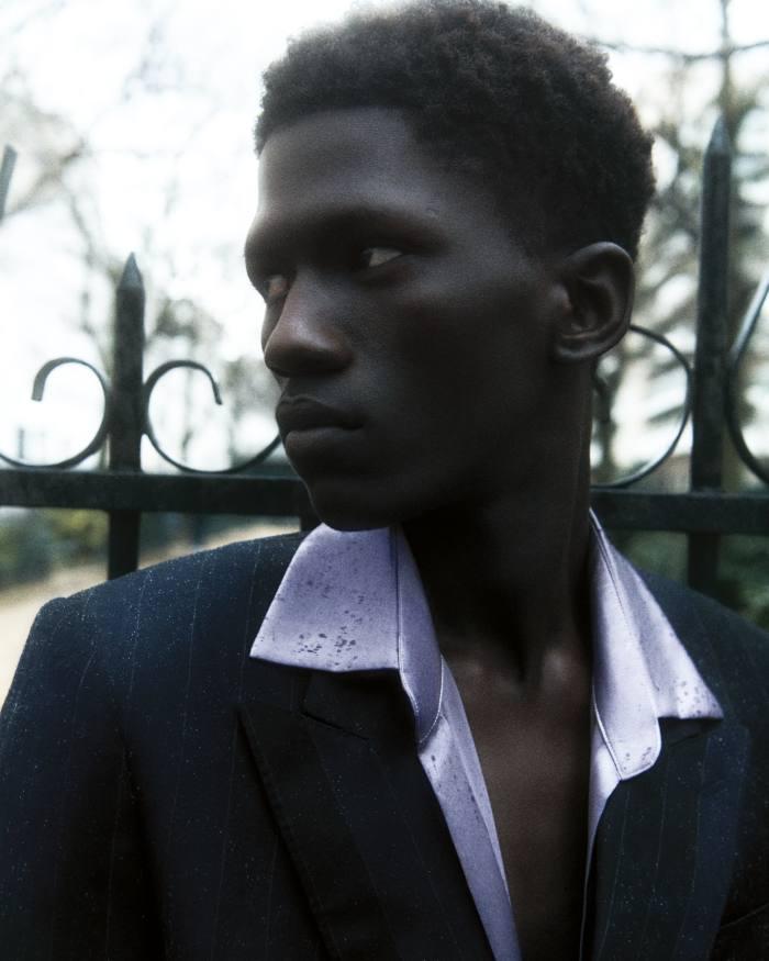 Moustapha wears Etro wool jacket, £1,125. Ludovic de Saint Sernin silkshirt, £475