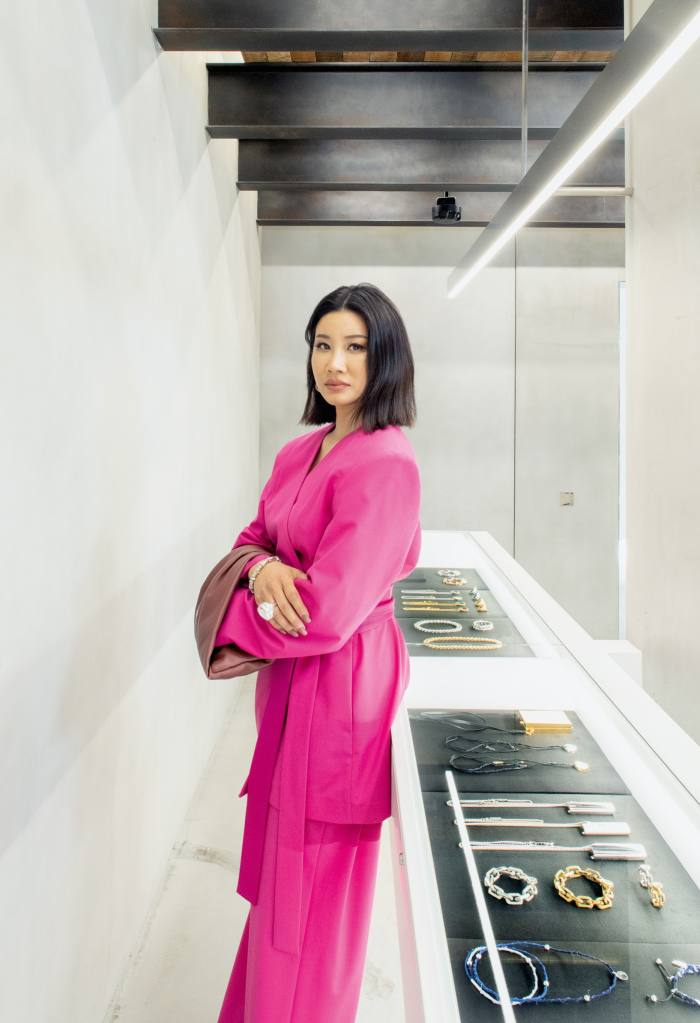 Yoon Ahn at the Workshop. She wears Ambush kimono suit blazer, back slit pants and wrap clutch