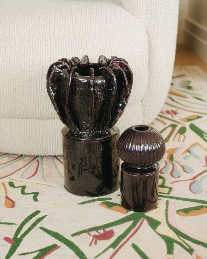 A pair of ceramic candle holders, produced by Atelier John Roger Paris