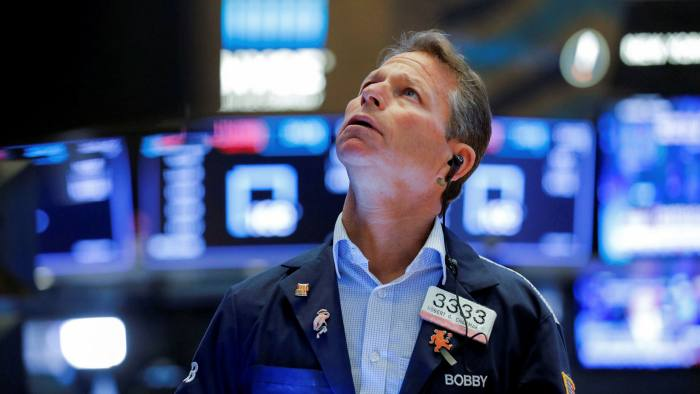 A trader works at the New York Stock Exchange
