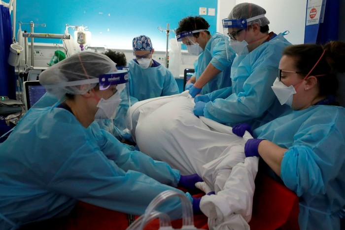 Critical Care staff turn a Covid-19 patient on the Christine Brown ward at King's College Hospital in London
