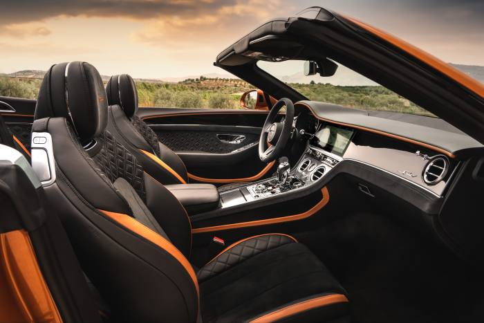 The interior features two-tone leather and Alcantara seats with diamond-quilted upholstery and embroidered Speed headrests
