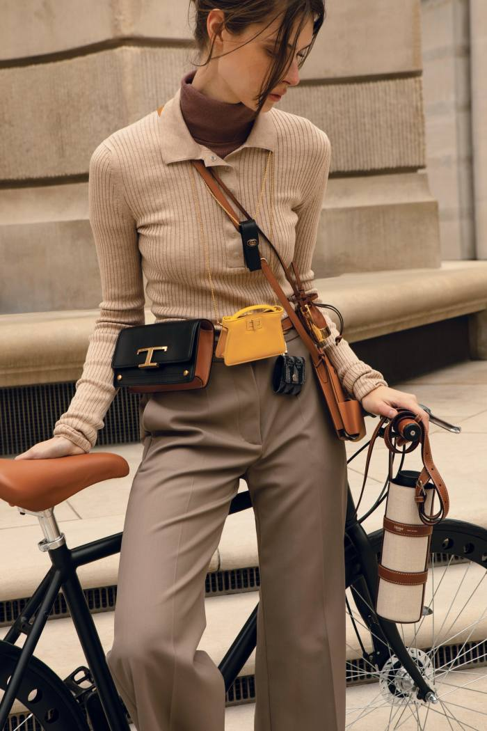 Raye silk-blend knitted polo shirt, £395, and cashmere rollneck, £225, from matchesfashion.com. Joseph wool Morissey trousers, £395. Accessories, clockwise from top: Gucci metal-free leather single porte-rouges bag, £225. Loewe leather and brass Balloon bag necklace, £495. Hermès leather Hermèsway smartphone case, £1,750. Au Depart reflective jacquard and leather AirPods case, £275.Fendi leather Pico Peekaboo charm bag, £650. Tod's leather T Timeless micro belt bag, £860. Onbike: Métier linen and leather water-bottle holder, £325. Larq stainless-steel water bottle, £95