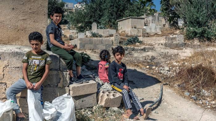 Vulnerable: Syrian refugee siblings outside their home in Amman, Jordan