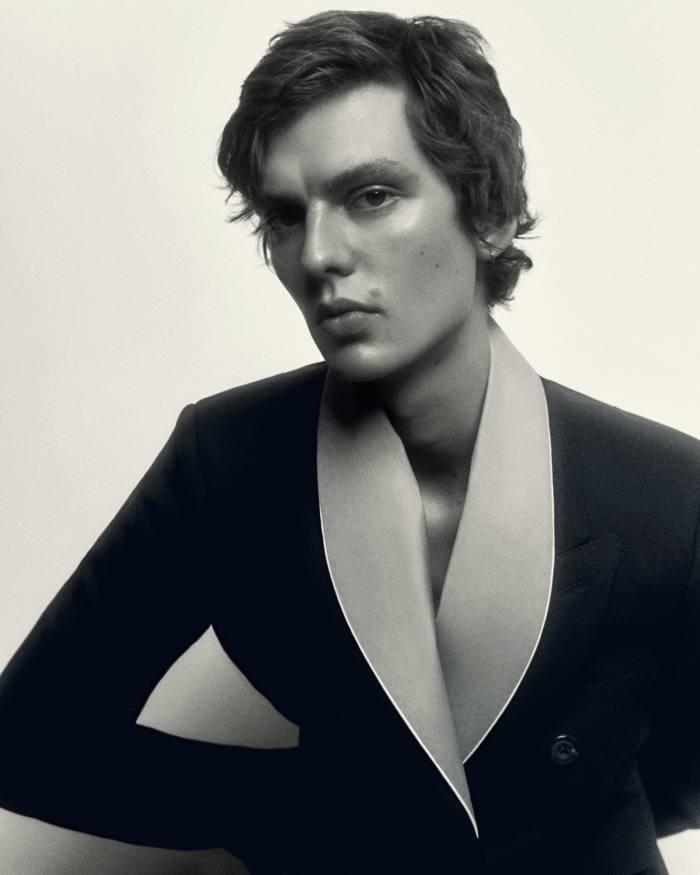 Leon Dame wears Alexander McQueen Wool Gabardine Coat, £2,740, Charvet Cotton Bathrobe, £665