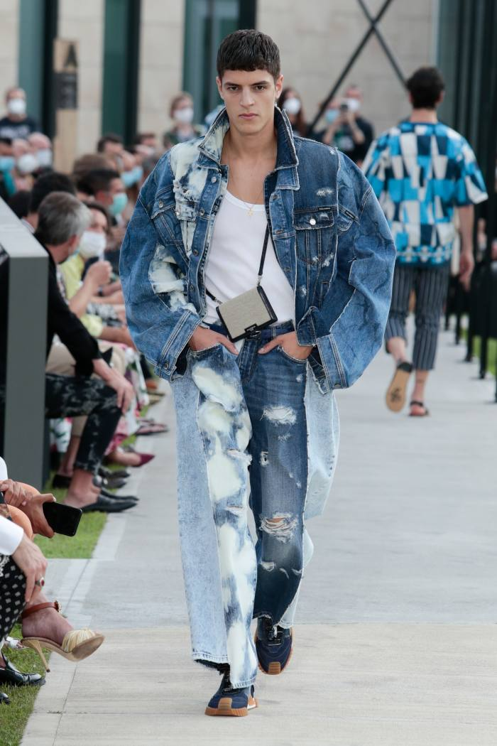 Dolce & Gabbana denim jacket, £2,350, tank top, £145, jeans, £1,300, and sneakers, £625
