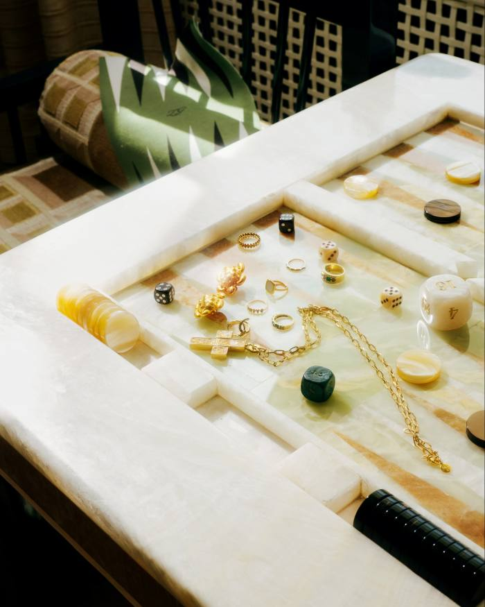 Assorted jewellery on a backgammon table