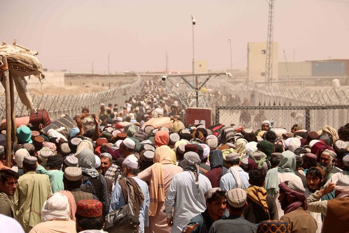 With the Taliban back in power, people wait to enter Pakistan at the Chaman border crossing on August 13