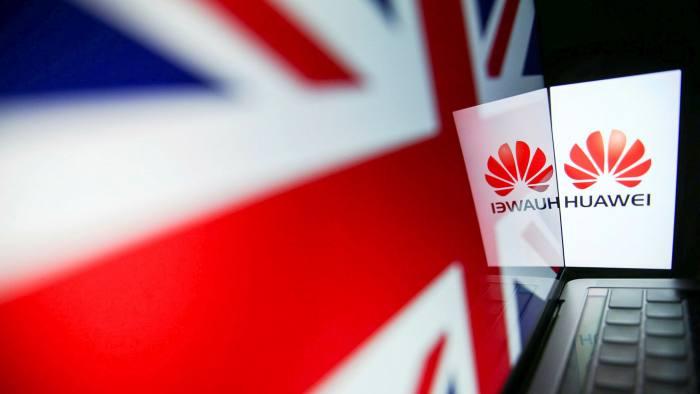 Huawei logo beside the Union Jack flag