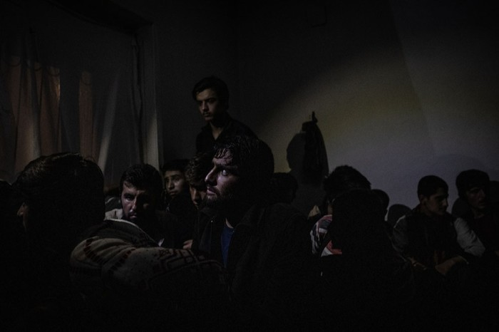 Afghan migrants waiting to be removed from a smuggler's safe house in Turkey, after a police raid in July.