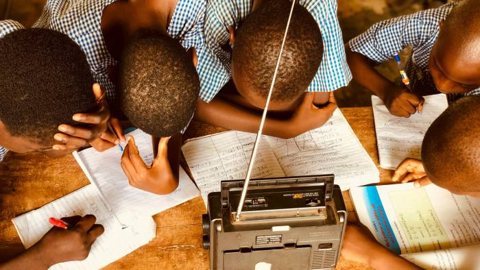 Pupils study with the Teach For Nigeria Remote Learning Program's radio school, launched in the pandemic