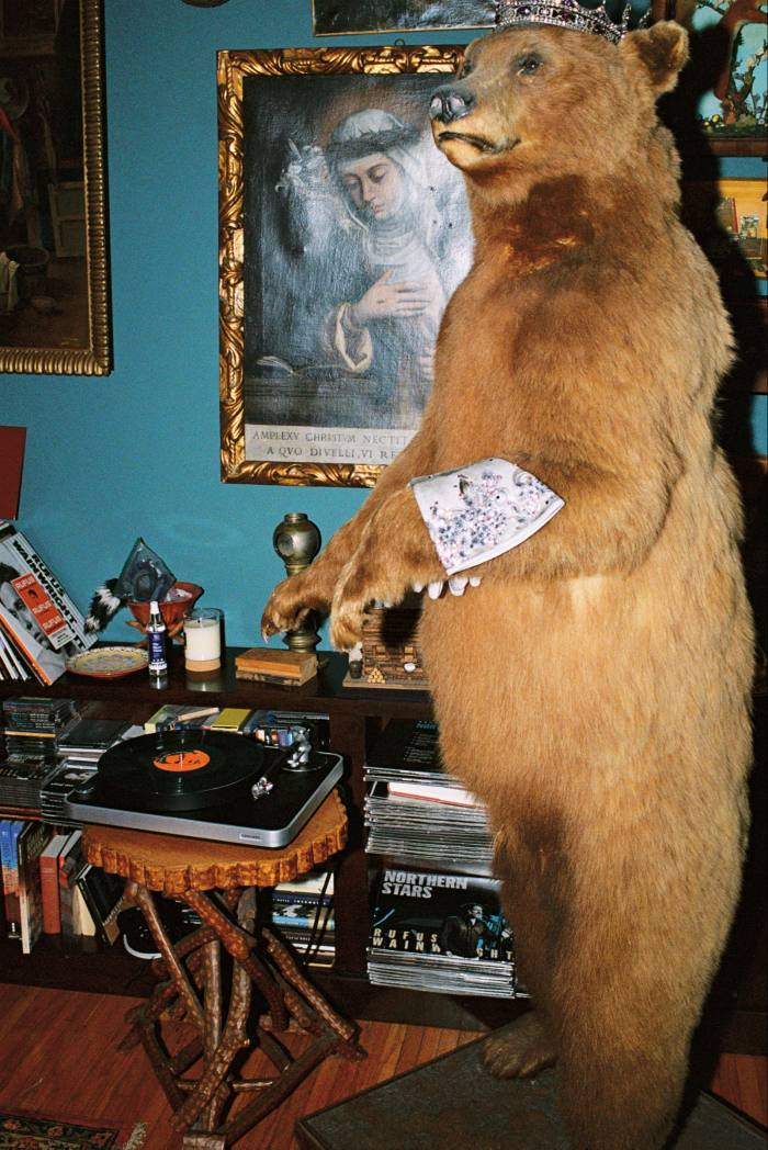 """The turntable given tohim by hishusband, beside""""the DJ"""", asecond-hand taxidermy bear"""