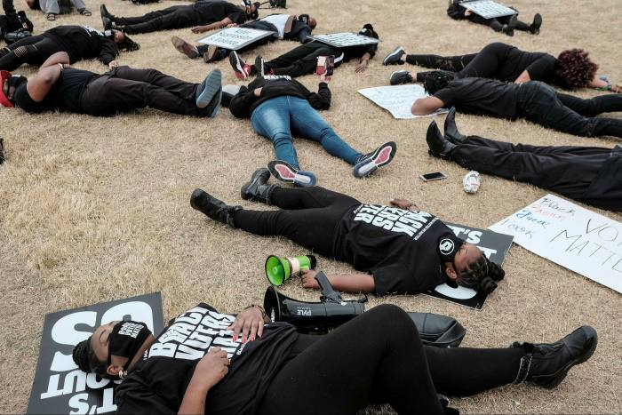 A 'die-in' outside World Of Coca-Cola in Atlanta, Georgia, after Coca-Cola did not oppose changes to voting laws that would make it harder for black voters to cast ballots