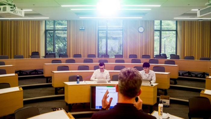 A professor at Berkeley's Haas School of Business teaches mostly online students last March