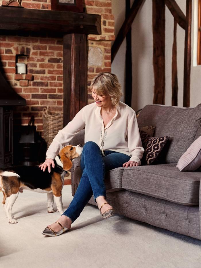 Sara Prentice at home near Maidstone, with Teddy, the family beagle