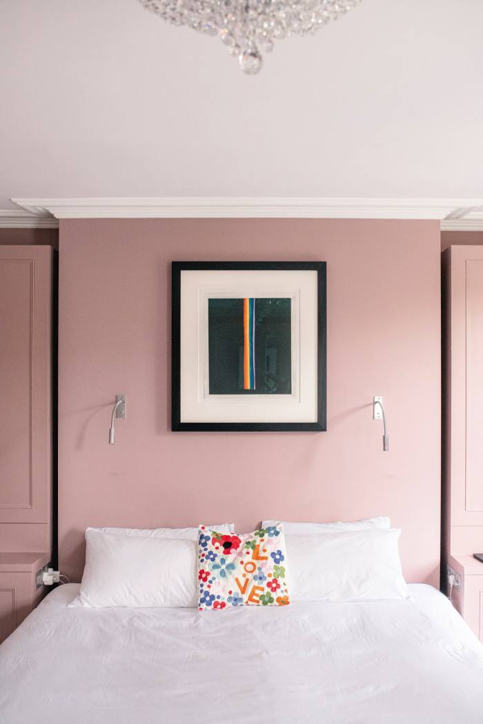 Coloured Etching by Norman Ackroyd hanging in a bedroom