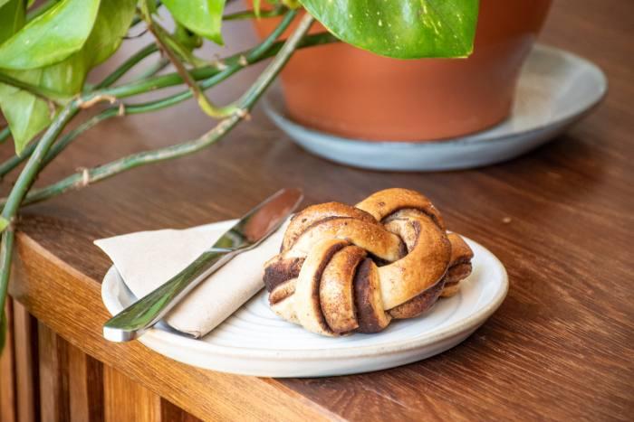 Fortitude serves single-origin coffees alongside sweet treats including cinnamon buns and brioche custard