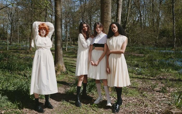 From left: Edwina wears Molly Goddard cotton dress, £820. Erdem leather shoes, POA. Socks, Edwina's own. Scarlett wears Molly Goddard cotton voile dress. Prada cotton socks, £90. Erdem leather boots, POA. Primrose wears Emilia Wickstead cotton shirt, POA, and cotton skirt, £895. Les Girls Les Boys cotton top (seen underneath), £25. Prada leather loafer shoes, £750, and cotton socks, £90. Megan wears Emilia Wickstead moiré Lou dress, £1,800. Prada leather loafers, £750, and cotton socks, £90
