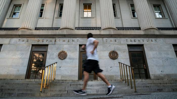 A man jogs past the US Treasury building