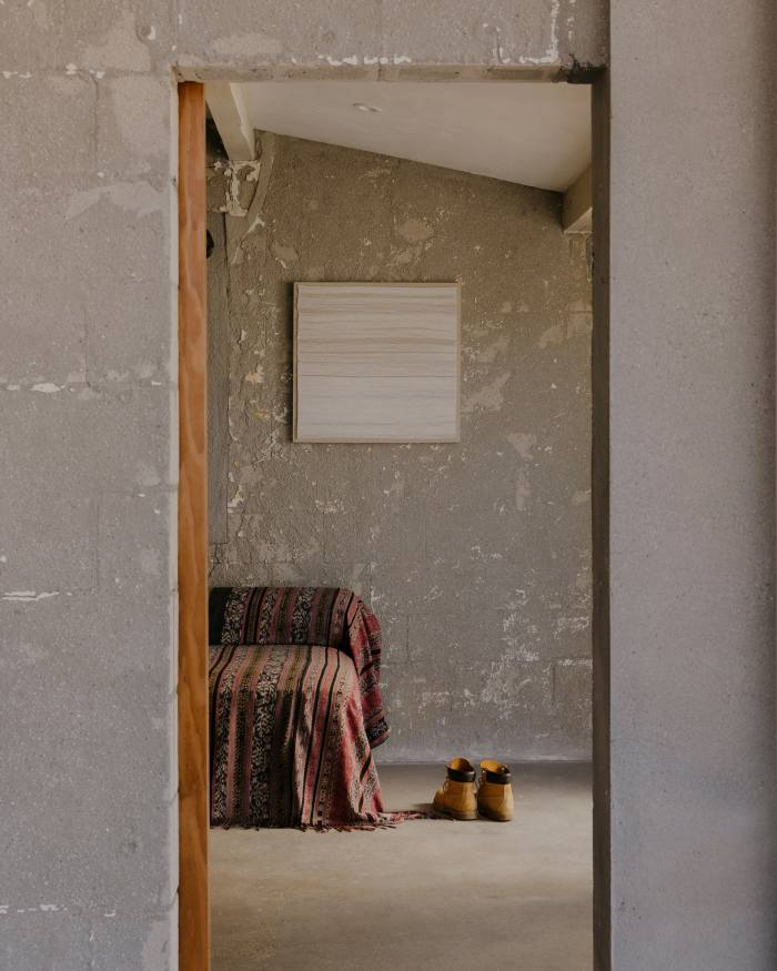 The house walls are stripped back 'so that the landscape could come into the space'
