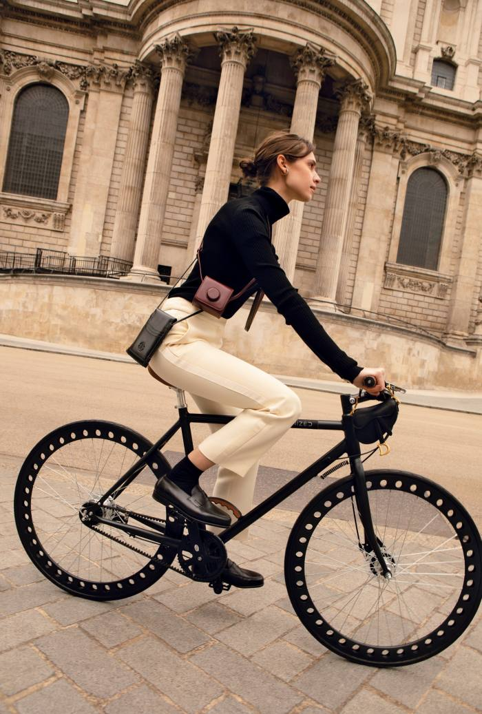 Dior cashmere rollneck, £1,500, wool and silk trousers, £1,100, and leather Saddle micro bag (held in front), £1,800. Succo bamboo socks, €32. John Lobb leather Lopez loafers, £1,015. Accessories, from left: Alexander McQueen leather TheCurve phone holder, £420. Lemaire leather Mini Camera bag, €490. Del'ep leather Smart glasses case, €145. Throughout: D'Heygere silver Vice Versa ear cuff,€230. Smartech Urbanized Gents 52Graphite bike, from selfridges.com