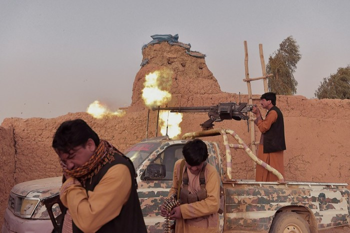 Anti-Taliban militia fighting on the outskirts of Lashkar Gah in March
