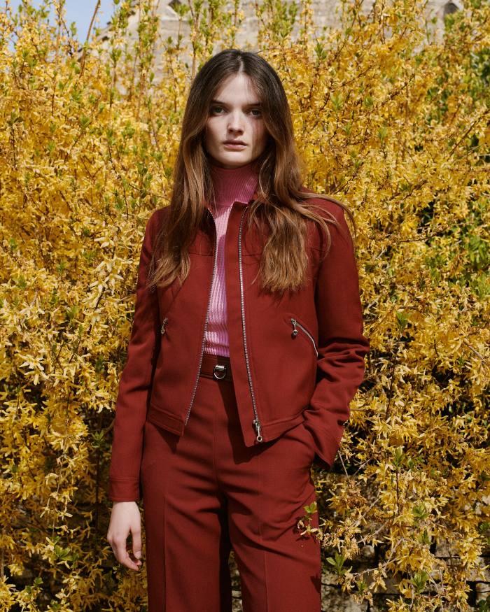 Primrose wears Hermès wool gabardine jacket, £2,500, cotton jumper, £1,500, and wool gabardine trousers, £1,800
