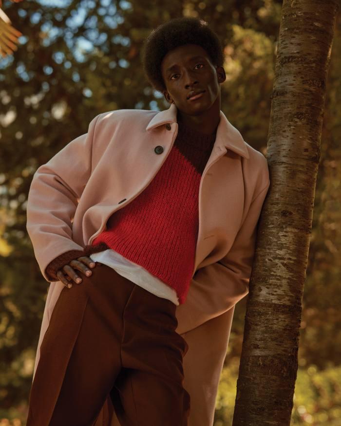 Prada wool coat, £2,900. Jil Sander byLucie and Luke Meier mohair jumper, £790, and wooltrousers, £690. Petit Bateau cotton T-shirt, £17