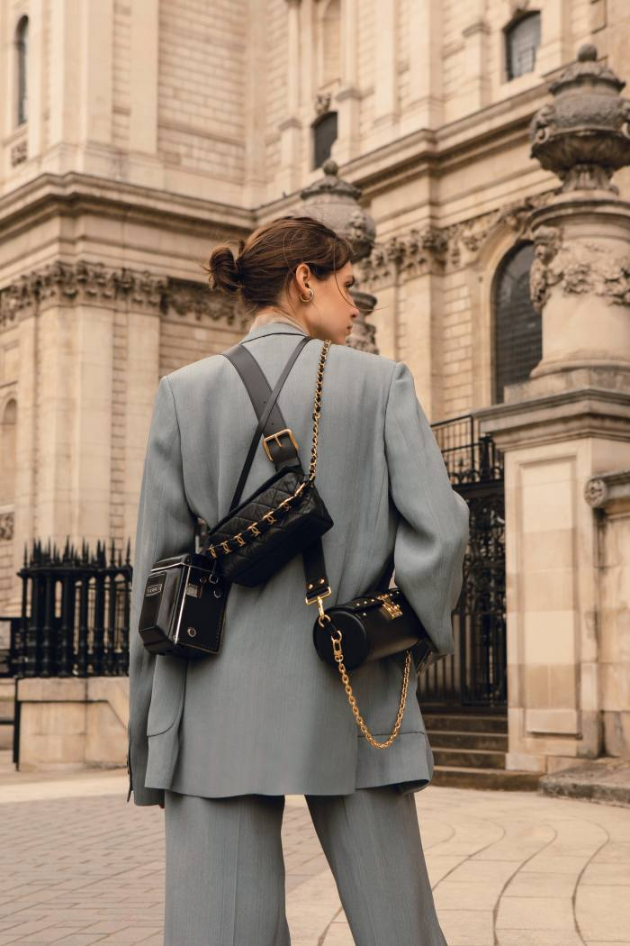 Petar Petrov silk jacket, £1,314, and matching trousers, £836. Joseph cashmere Cashair rollneck, £275. Accessories, from left: Yashica D camera, stylist's own. Chanel crumpled leather handbag, £3,030. Louis Vuitton leather Papillon Trunk bag, £1,810