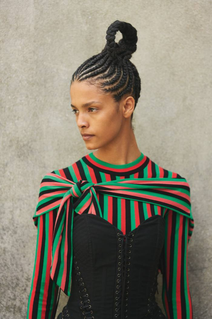 Stripes get a spectacular upgrade. Opposite page: Laiza wears Dolce & Gabbana stretch-fabric and boning lace-up bustier, £2,351. Kenzo cotton jumper and cotton snood, both POA
