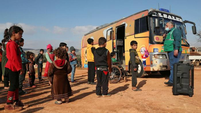 Children at the Haranbush camp for displaced Syrians in Idlib province