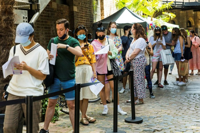 People queue at a pop-up Covid-19 vaccination centre in Camden, London